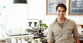 Young man working at a coffee shop